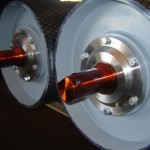 Rollers for belt conveyors